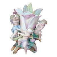 Spectacular Porcelain Bisque Angels playing Blind mans Bluff around a Tulip Vase