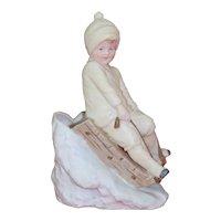 Beautiful Porcelain Heubach Boy Sledding Down a Steep Hill Snow Baby Christmas