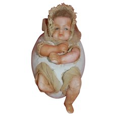 Remarkable German Wax Baby coming from Paper Mache Egg Candy Container
