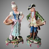 Pair ANTIQUE 19th Century Austrian MAJOLICA FIGURINES Colonial Couple w Baskets