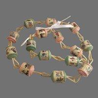 Celluloid Plastic Nursery Rhyme Story Book Baby Crib Rattle Swag