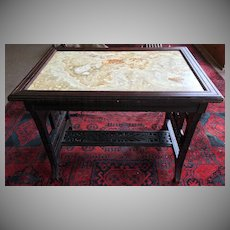 Aesthetic Movement Ebonized Center Table with Figurative Marble Top