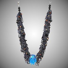 Blue Hamsa Necklace with Multicolor Metallic Seed Beads