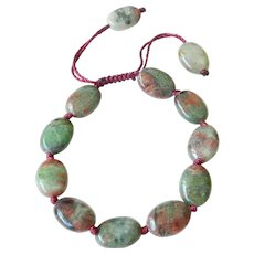 Green-Red Flat Oval Garnet Bracelet, adjustable