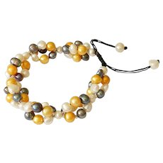 Pearl Bracelet with Freshwater cultured White, Gold and Black Pearls