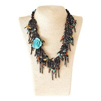 Black Seed Necklace with Turquoise Color Carved Coral Flower, Turquoise, Carnelian, Yellow and Green cultured Pearls