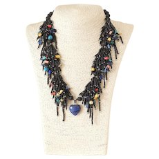 Black Seed Multi-Strand Necklace with Lapis Lazuli Heart Pendant, Lapis Lazuli, Round Black Lava stones, Turquoise, Red & Peach Corals, Blister cultured Pearls