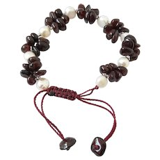 White Freshwater Pearls(cultured) with clusters of Garnet Gemstone Bracelet