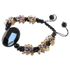 Black Onyx Gemstone Bracelet with Purple and Yellow Crystals
