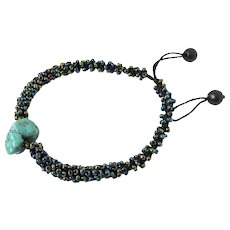 Turquoise Bracelet with Green Blue Purple Seed Beads Woven into Macrame Adjustable Cord