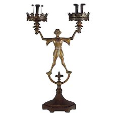 A Gothic Revival iron and bronze candelabrum of Till Eulenspiegel, probably German, circa 1865.