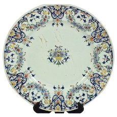 A large early 18th century Rouen faience plate decorated in the 'style rayonnant', circa 1710