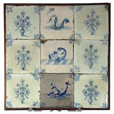 A framed set of nine 17th century Delft tiles, circa 1650-1700.