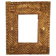 An antique American carved and gold leafed picture frame, probably desert South-West or northern Mexico