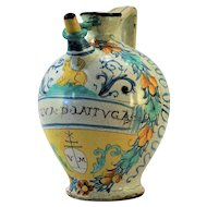 An early 17th century Italian polychrome majolica 'wet' or syrup drug jar dated 1620, probably Montelupo, Tuscany