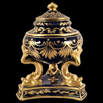 An early 19th century Derby porcelain potpourri, or perfumier, circa 1810