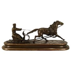 A Russian Imperial Bronze of a man on a sled, Vasily Grachev, St. Petersburg, circa 1880