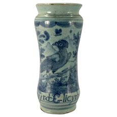A 17th century Italian majolica drug jar decorated in the 'berittino style, probably Venetian, dated 1690