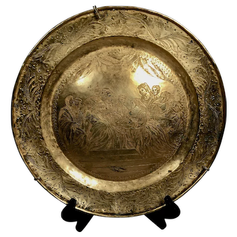 A large 16th century engraved brass charger, probably Venetian circa 1600