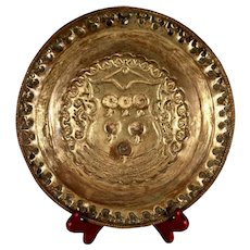 An early 17th century armorial brass plate, probably Venetian circa 1620
