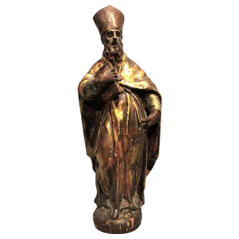 A late 17th century Italian Baroque carved wood, gilded, and polychromed statue of a saint, probably Rome, circa 1670