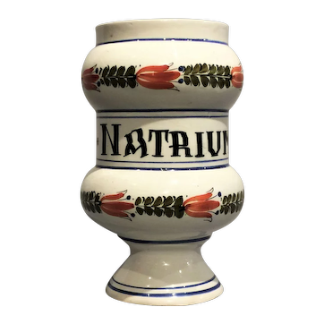 An early 19th century French faience drug jar, probably Quimper circa 1825