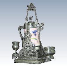 Outstanding silver plated tilting water set by Simpson, Hall, Miller & Co, Waterford, Ct., 1891