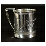 A fine American Sterling silver christening cup in the early Japanese Aesthetic style, Gorham Mfg. Co., Providence, Rhode Island, 1873