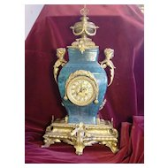 Turn of the century palatial Chinese porcelain Gilded French figural bronze mounts mantel clock