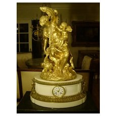 Antique palatial gilded bronze figural French mantel clock marble signed  MOREAU