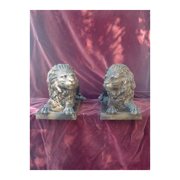 Pair of large vintage patinated bronze statues lions