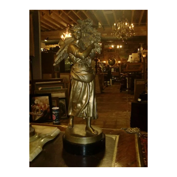 19th C. French Bronze sculpture of a woman carrying sheaves of wheat. signed Albert Lefuvre