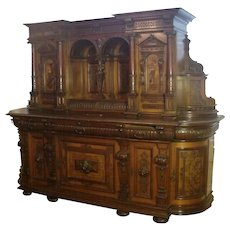 An impressive  Imposing Continental Renaissance Revival marquetry inlaid carved walnut buffet, French, 19th c.