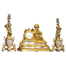 Original Period French Gilded bronze figural three piece graniture set, sevres style, cherubs, circa 1880, museum quality