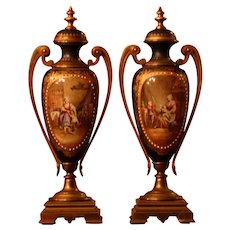 French Pair of Hand Painted Porcelain Urns, bronze handles & base,jewels, signed, circa 1870