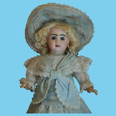 A Sweet Captivating Antique French Tete Jumeau Doll with a Elegant Costume and Original Undergarments