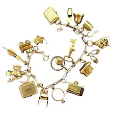 Rare Early to Mid Century 14K gold charm bracelet with 10K-14K-18K Moveable Mechanical Charms