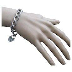 Vintage Sterling Silver Repousse Charm Bracelet with Repousse Heart padlock clasp