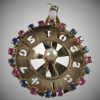 14K Gold Wheel of Fortune Rubies Sapphires Pearl and Opal Charm