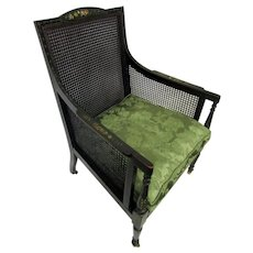 19th Century English Regency Painted Ebonized Wooden and Caned Armchair