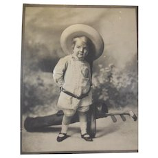 Large Advertising Puffy Photographic Image of Adorable Toddler Dressed in Golf Attire with Clubs, 1904