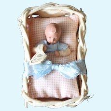 Caco vintage baby in original wicker bassinet