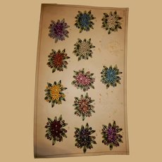 Antique salesman's sample board of French silk embroidered appliques.