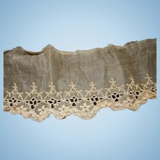 Antique embroidered net lace with cut work.