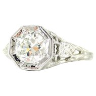 Filigree Diamond Engagement Ring, 0.77 ctw Old Cut Diamond in Floral Style Filigree Stamped 18k White Gold Setting by Jabel, Circa 1930s.