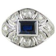 Art Deco Sapphire & Diamond Platinum Cocktail Ring. Bombé Style Ring, Old European Cut Diamonds with Baguette Cut Blue Sapphire, 1930s.