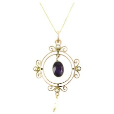 Edwardian 9ct Amethyst & Seed Pearl Pendant. Circular Pendant with Articulated Gemstones in Scalloped Frame, Circa 1900.