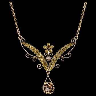 Art Nouveau Laurel Diamond Necklace, Antique 14k Two Tone Gold Floral Pendant, Circa 1900.