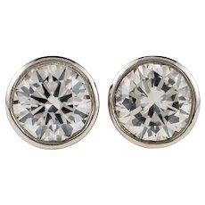 Bezel Set Diamond Stud Earrings, 0.42 ctw Round Brilliant Cut Diamonds in Platinum Rubover Settings.