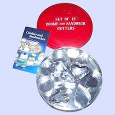 Charming Vintage Tin with Pamphlet and 12 Cookie Sandwich Cutters
